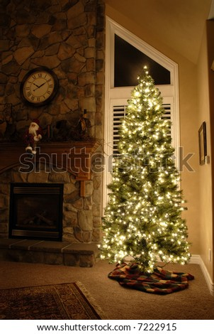 Front room decorated for christmas with christmas tree and fireplace - stock photo