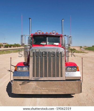 Front shot of a red truck. - stock photo