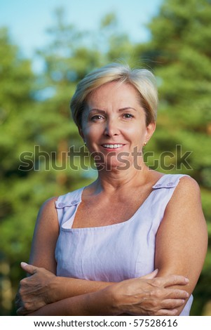 Front shot of cheerful mature woman - stock photo