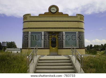 Front shot of 1950's metal manufactured diner with clock on top. - stock photo