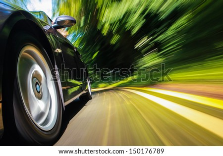 Front side of driving fast car. - stock photo