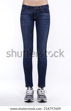 Front side view of a standing woman(female) model wearing denim(trousers) isolated on a white background