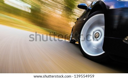 Front side view of black car in turn. - stock photo