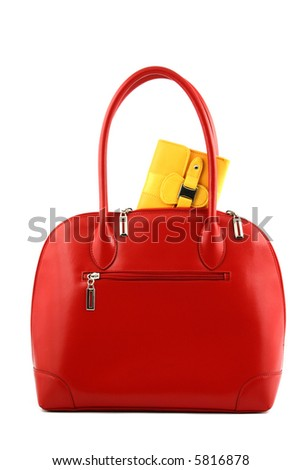 Front view at red handbag with yellow wallet half put into it