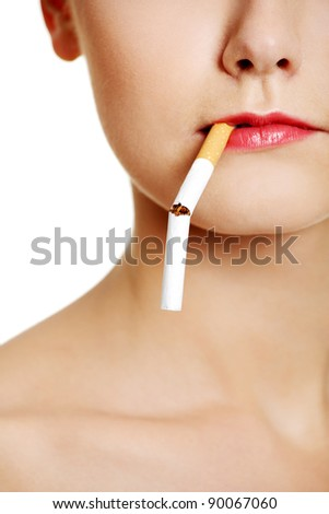 Front view face closeup holding a broken cigarette in lips, over white.
