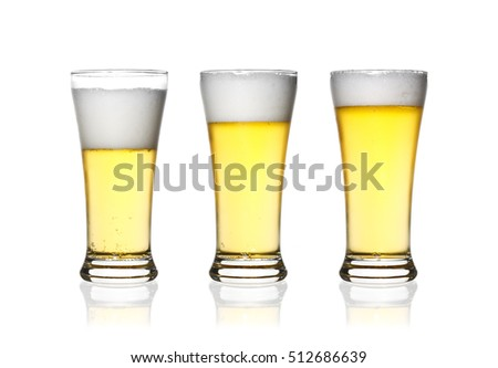 front view frosty lager light beer three level set in clear glass with white bubbles and steam for winter drink or celebration isolated on white background and reflection for beer glass