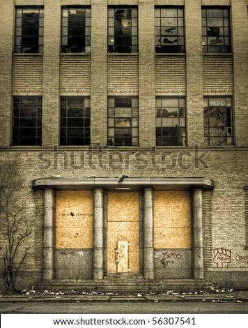 Front view of a boarded-up abandoned building from the street in Detroit, Michigan. - stock photo