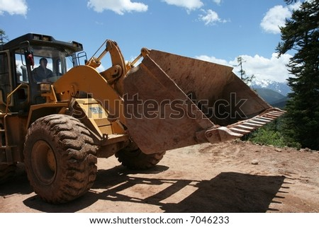 Front view of a bulldozer - stock photo