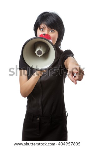 Front view of a business woman using a megaphone raised up to her mouth