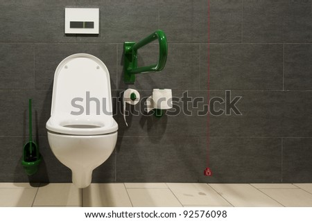 front view of a closet for handicapped people with red emergency wire - stock photo