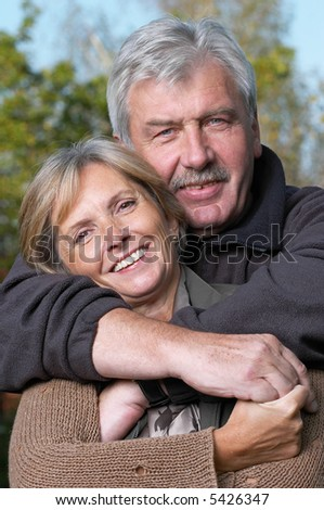 Front view of a happy mature couple. Focus on the woman. - stock photo