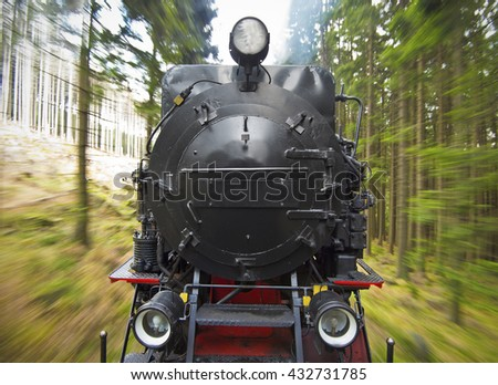 front view of a historic German black steam powered railway train in motion blur, National Park Harz, Germany - stock photo