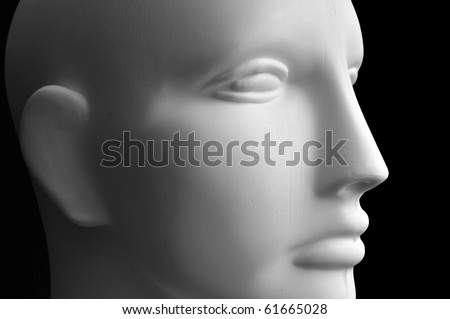 Front view of a mannequin dummy head isolated on a black background. - stock photo