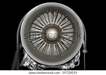 Front view of a modern fighter engine over black background. - stock photo