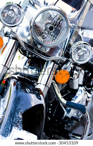 Front view of a motorcycle with blue tint. - stock photo