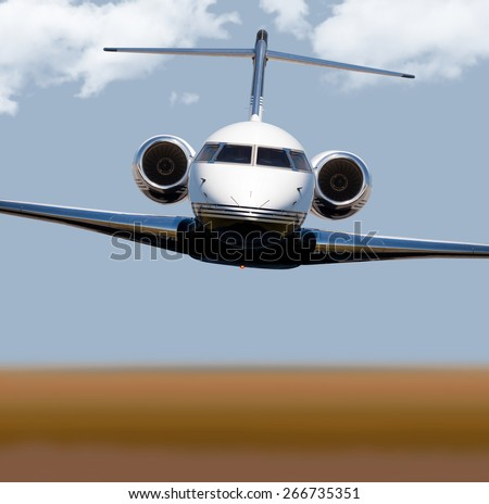Front view of a private jet in-flight  - stock photo