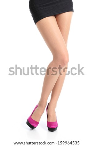 Front view of a woman legs with fuchsia high heels posing standing isolated on a white background        - stock photo
