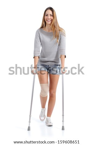 Front view of a woman walking with crutches isolated on a white background               - stock photo