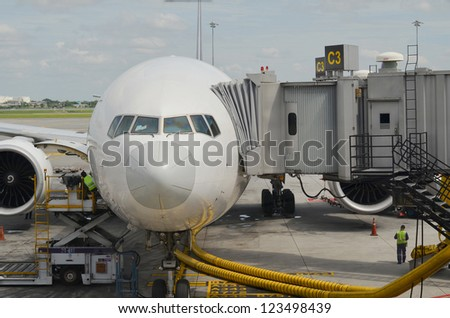 Front view of airplane at gate - stock photo