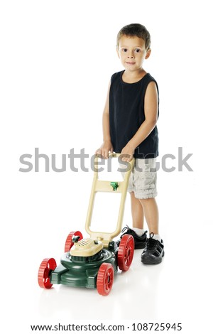 Front view of an adorable preschooler preparing to mow a lawn with his toy lawn mower.  On a white background. - stock photo