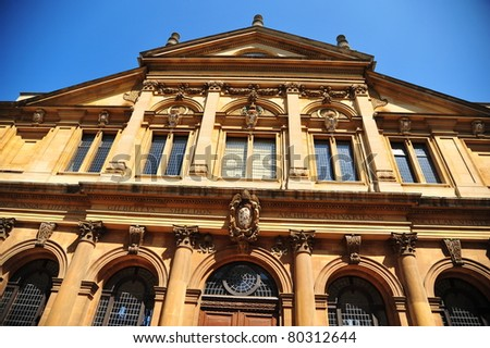 Front view of an old academy - stock photo