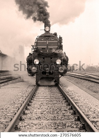 Front view of an old-fashioned steam locomotive in an austrian railway station. Scan from a  B&W negative. - stock photo
