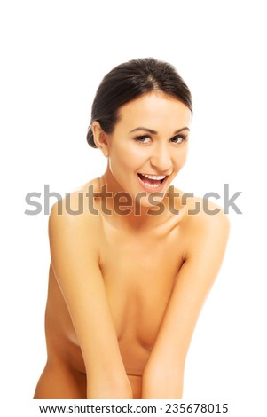 Front view of beautiful nude woman laughing to the camera.