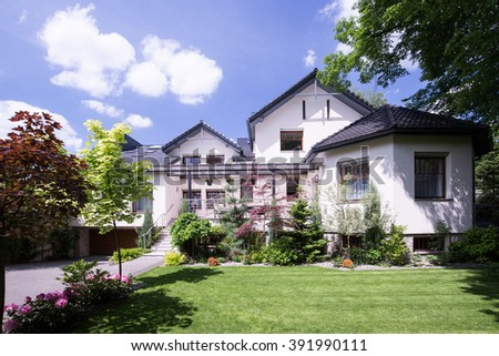 Front view of beautiful white house on the suburbs  - stock photo