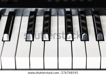 front view of black and white keys of digital piano close up - stock photo