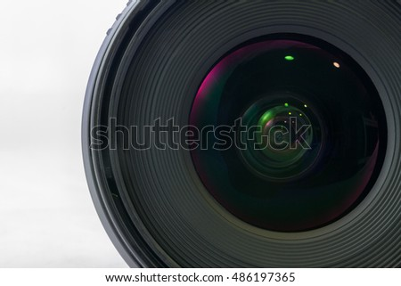 Front view of black camera lens isolated on white background, glass side of lens