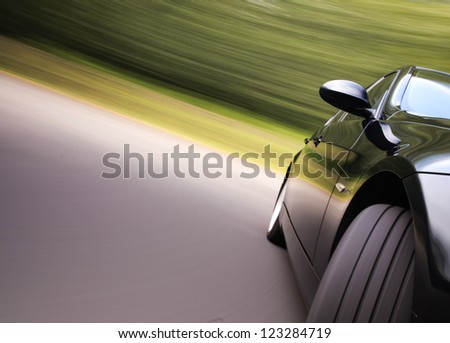 Front view of black car in turn - stock photo