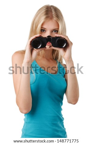 Front view of blond beautiful female with binoculars looking at you - stock photo