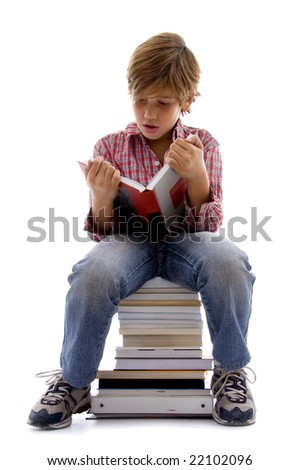 front view of boy sitting on books with white background - stock photo