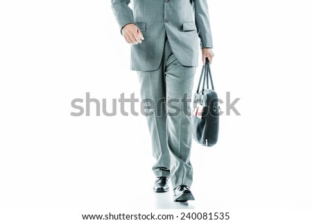 Front view of  business mans hands and legs carrying a bag isolated on white - stock photo