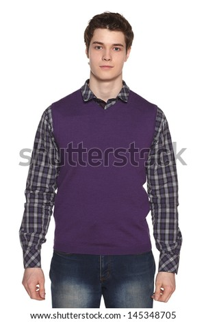 Front view of calm young man standing against white background - stock photo