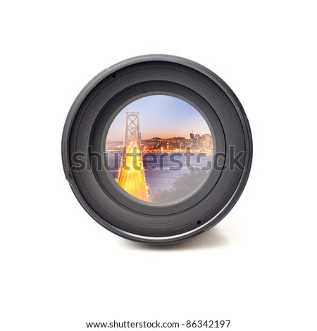 Front view of camera lens with bay bridge image reflection - stock photo