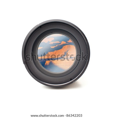 Front view of camera lens with grand canyon image reflection - stock photo