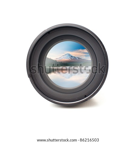 Front view of camera lens with mountain and water reflection image reflection - stock photo