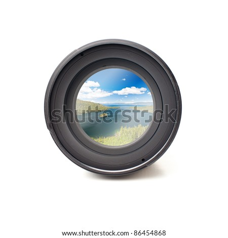 Front view of camera lens with ocean landscape image reflection - stock photo