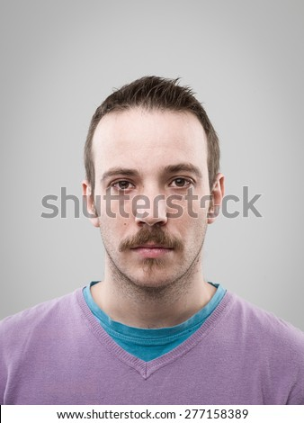 front view of caucasian man with blank expression. real people portrait - stock photo