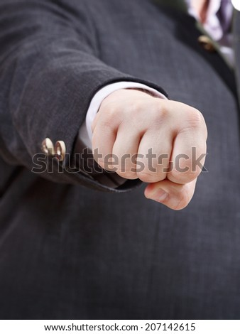 front view of clenched fist of businessman - hand gesture