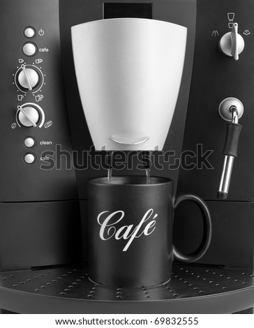 Front view of coffee machine with black cup - stock photo