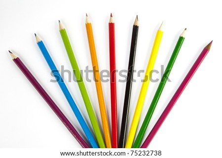front view of color pencils over white background