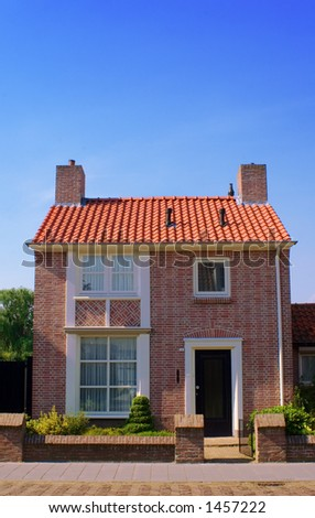 front view of cosy little house - stock photo