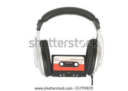 front view of dj headphones and audio cassette - stock photo