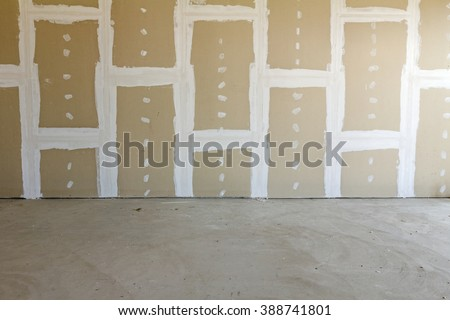 Front view of gypsum wall with joints at building site - stock photo