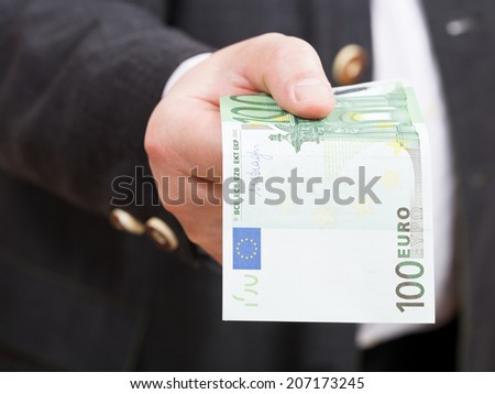 front view of hundred euro banknote in hand close up - stock photo