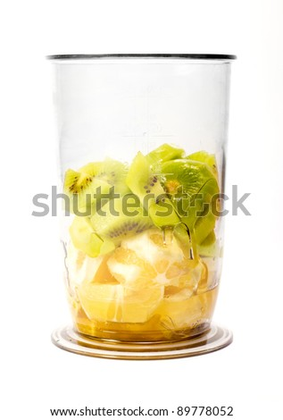 Front view of kiwi and orange pieces in plastic cup