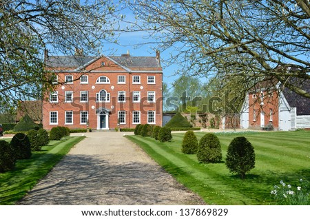 Front View of large Georgian Mansion with Drive - stock photo