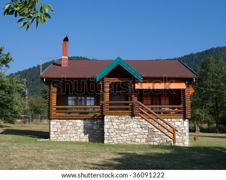 front view of log cabin in land considered the Swiss Alps of Greece - stock photo